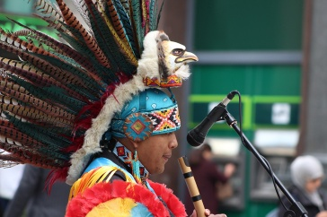 An eagle wearing traditional human costume