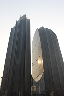 This building/buildings look like it's/they're covered in cling film.